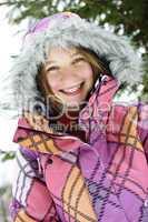 Happy winter girl in ski jacket