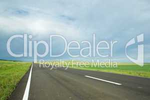 asphalt road in field