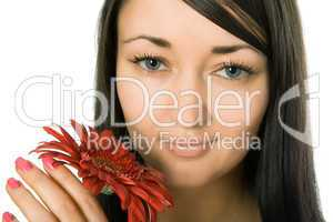 Young pretty woman holding red gerbera flower