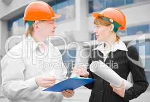 architects man and woman  protective helmet