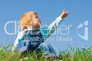 child on green grass