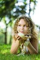 young beauty woman in park with flower