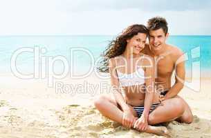 Attractive young couple on the beach