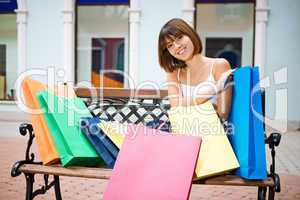 young woman with multi-coloured bags