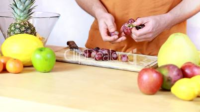 Preparing grapes for a fruit salad