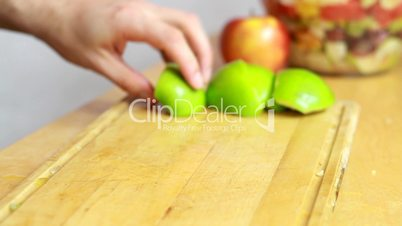 Slicing green apple