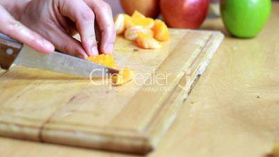 Close up of slicing mandarin