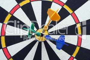 dartboard with darts in aim