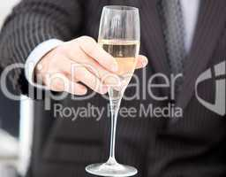 Close-up of a businessman celebrating an event with champagne