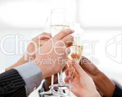 Close-up of businessmen celebrating an event with champagne