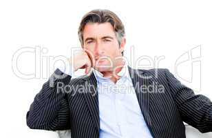 Attractive businessman looking at the camera against white backg