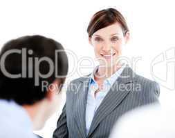 Portrait of a confident businesswoman talking at her colleague d