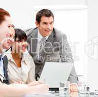 Portrait of anice businesswoman working with her colleagues