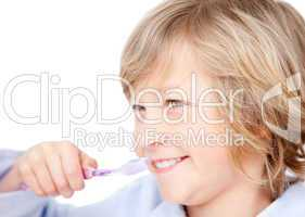 Caucasian child brushing his teeth