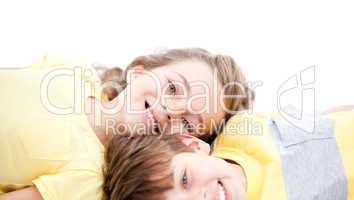 Happy childrens lying on the floor together