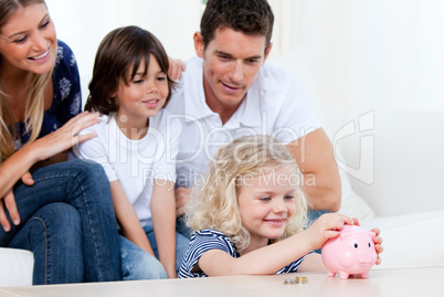Positive family using a piggy bank