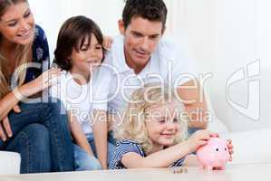 Positive family using a piggy bank