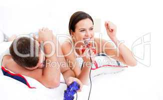 Positive couple playing video games