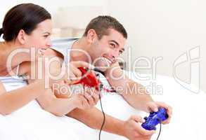 Joyful couple playing video games