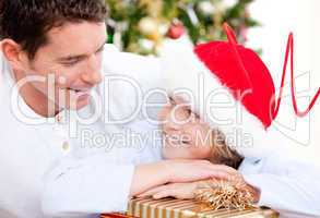 Attractive father celebrating christmas with his son