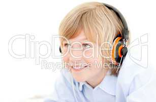 Portrait of a cute boy listenning music