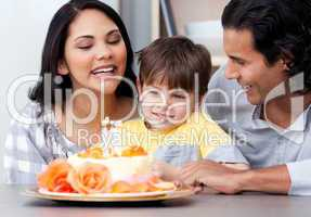 Smiling family celebrating a birthday together