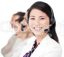 Cheerful business people with headset on standing