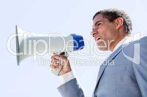 Charismatic businessman yelling through a megaphone