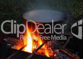 kettle over campfire