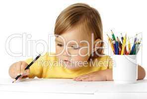 Cute preschooler focused on drawing
