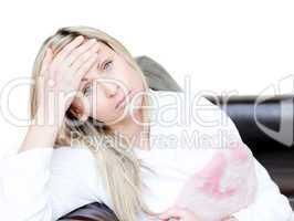 Pensive woman have a headache