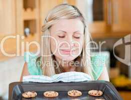 Delighted housewife preparing cookies