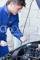 Professional man repairing a car