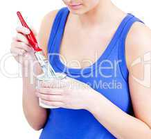 Beautiful woman using a paintbrush