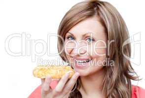 Bright woman eating a cake