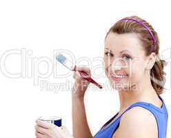 Confident woman using a paintbrush