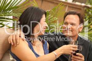 Attractive Hispanic and Caucasian Couple Drinking Wine