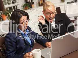 Businesswomen Celebrate Success on the Laptop
