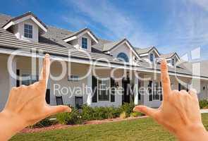 Female Hands Framing Beautiful House