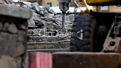 tractor with paving breaker destroy  stair close-up