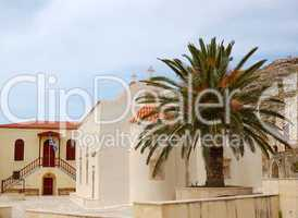 Orthodox Church and palm tree, Crete, Greece