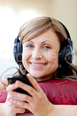Delighted woman is listening the music in the living-room