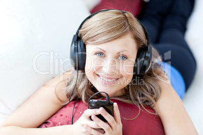 Teen woman is listening the music in the living-room
