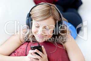 Joyful woman is listening the music in the living-room