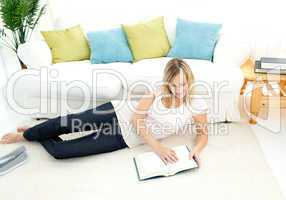 Charming woman is reading a book