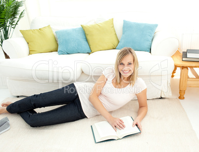 Cute woman is reading a book
