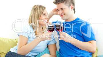 Charming couple drinking wine together