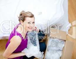 Delighted woman having a break between boxes