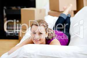 Cheerful woman having a break between boxes