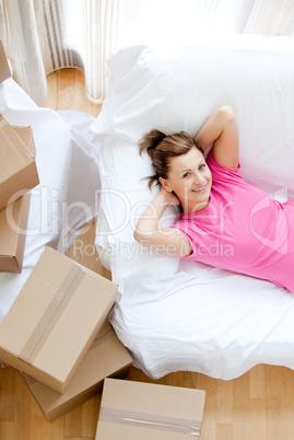 Beautiful woman having a break between boxes